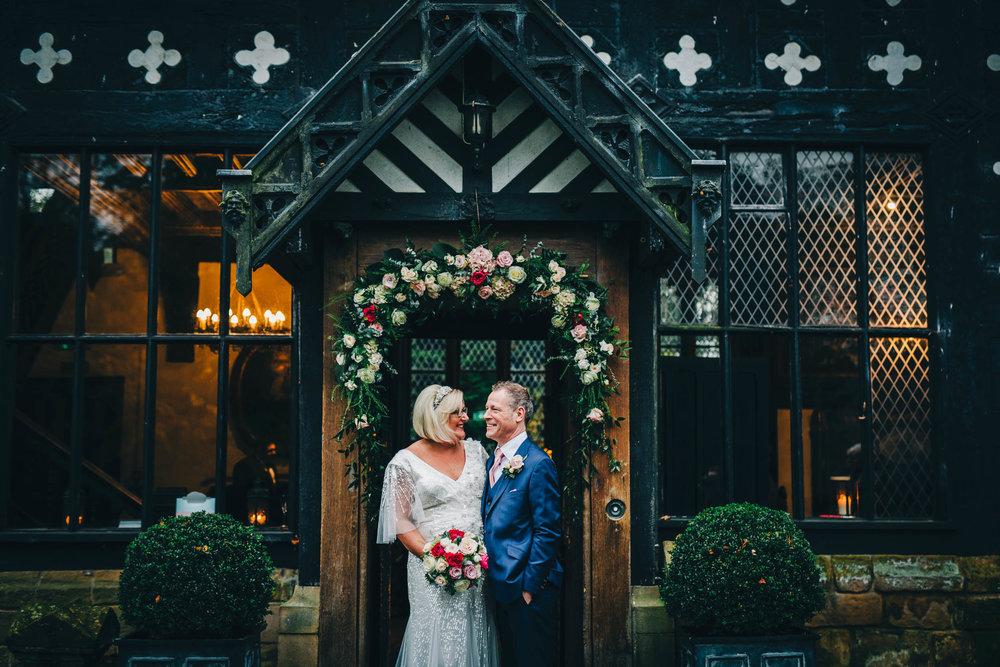 relaxed couple's portraits outside Samlesbury Hall