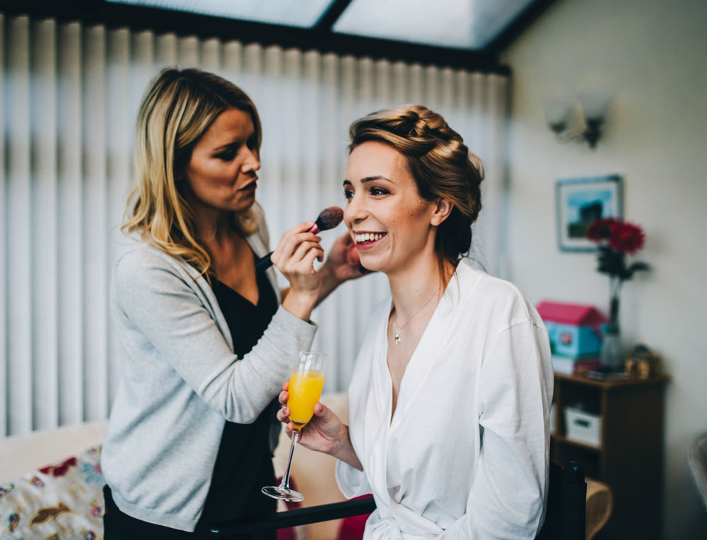 bride having make up done - Lake District wedding photography