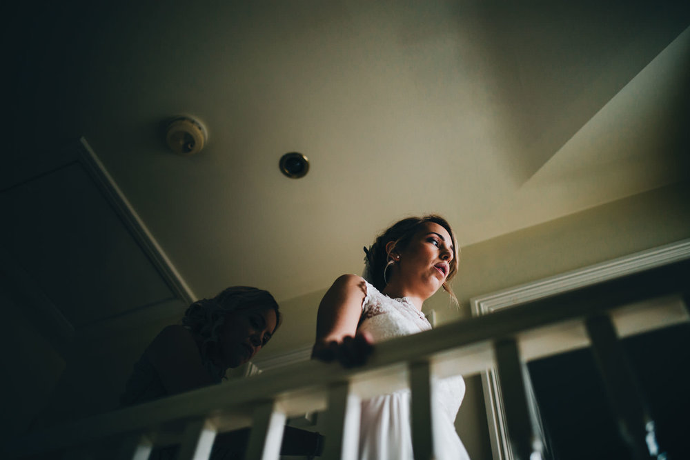 beautiful light as bride gets dressed - creative wedding photographer