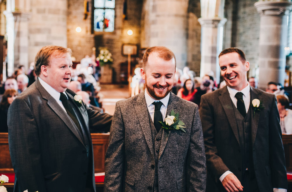 groom waits nervously for the bride to arrive - lake district wedding photography