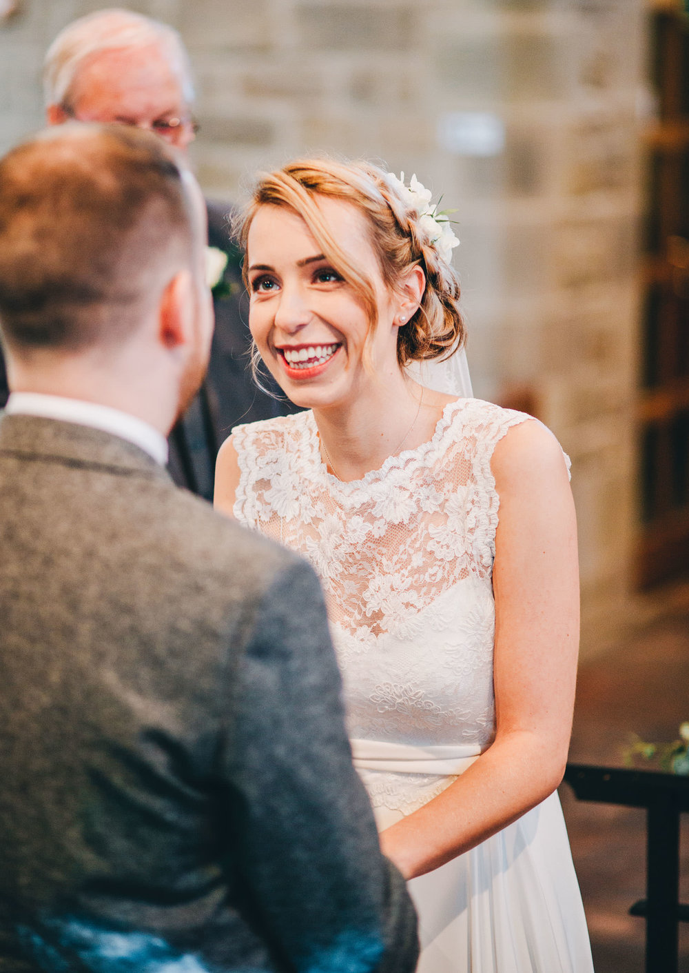 bride laughs as they exchange vows - lake district wedding photography