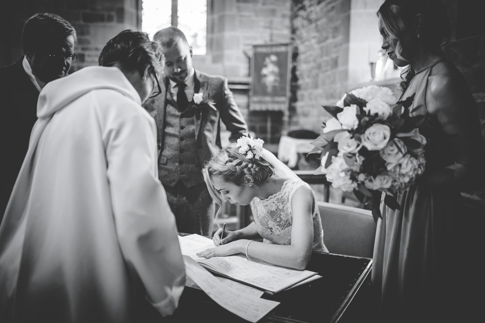 signing the register at Lake District wedding