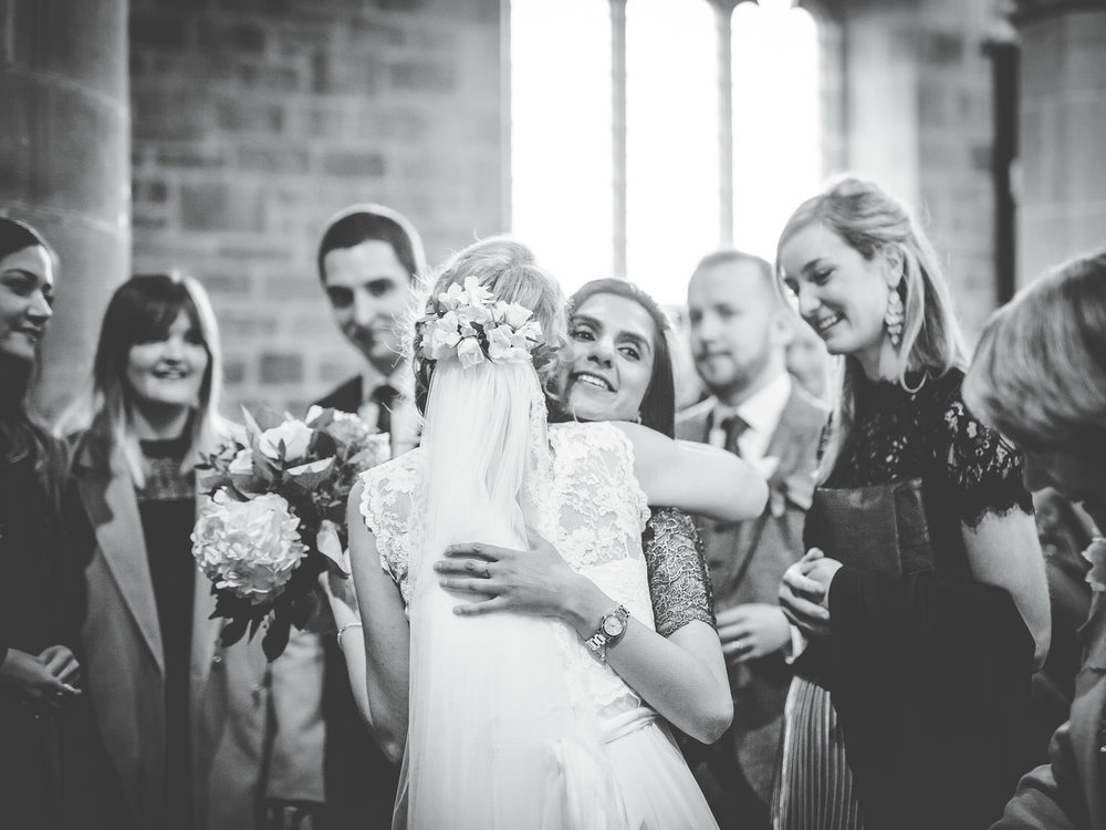 a hug with the bride - lake district wedding pictures