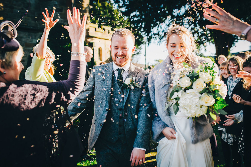 fun wedding photography in the lakes - confetti outside church
