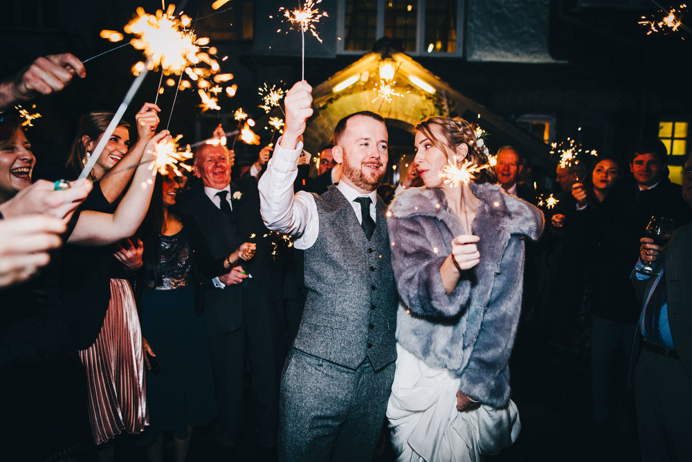bride and groom use sparklers outside the Ryebeck Hotel