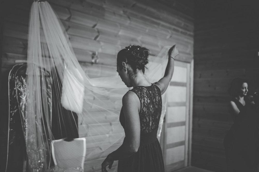 bridesmaid looks at veil - docmentary wedding photographer Cheshire
