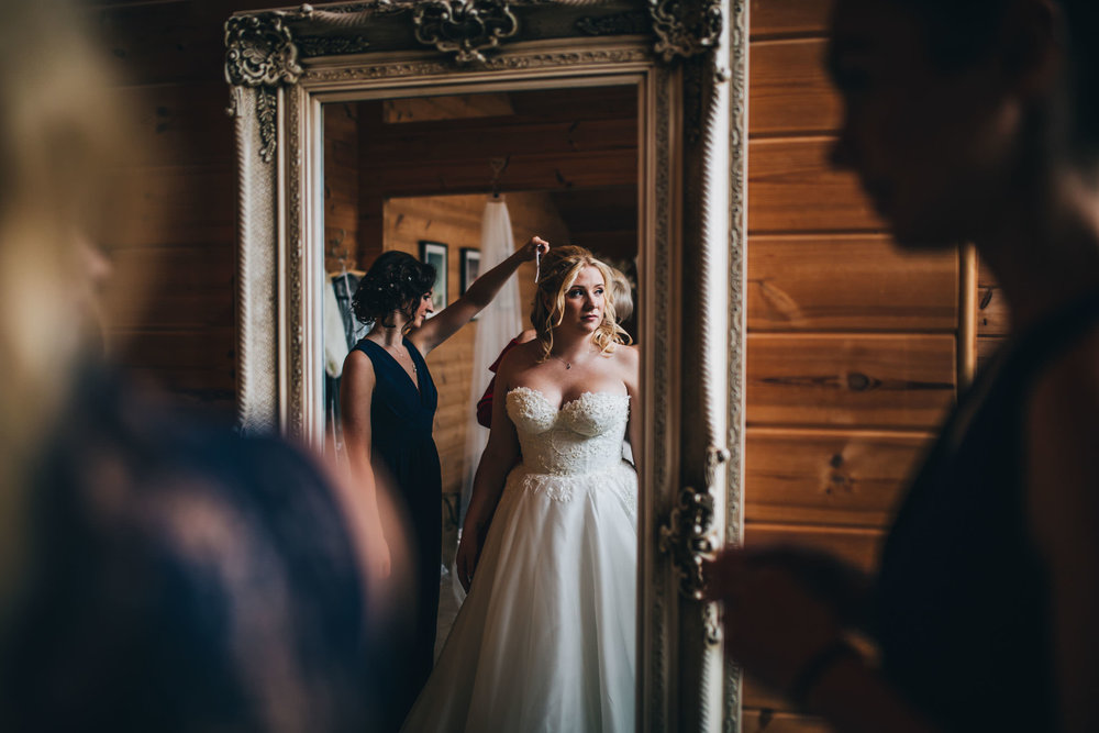 Bride getting dressed - wedding photography in cheshire