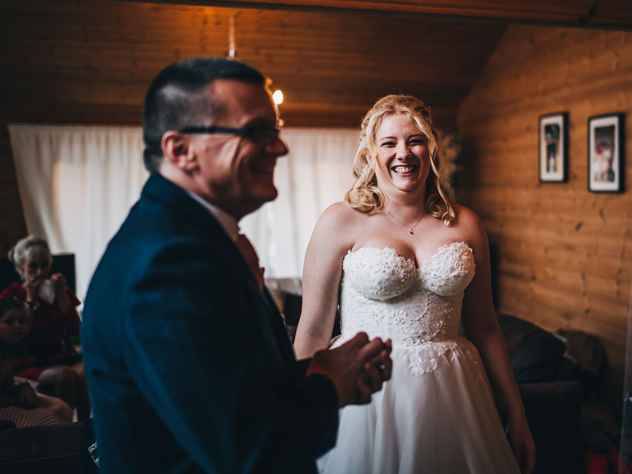 relaxed wedding photography cheshire - bride laughs at dad