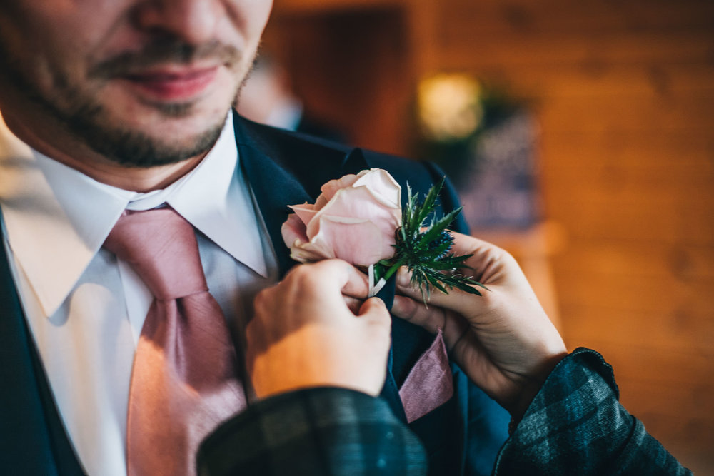 groom gets the buttonhole
