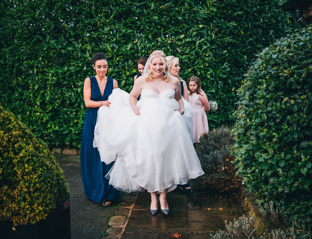 bride walking to the ceremony at STyal Lodge