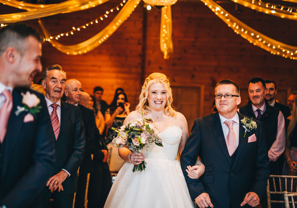 bride walks down the aisle to the groom