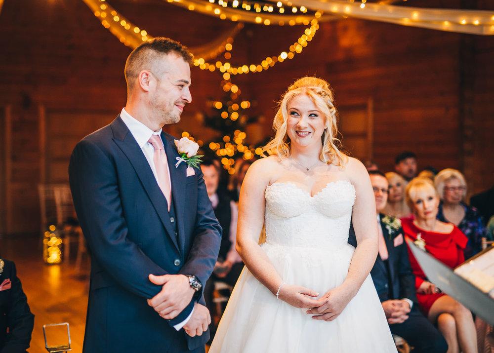 bride and groom exchange glances - wedding day at styal lodge