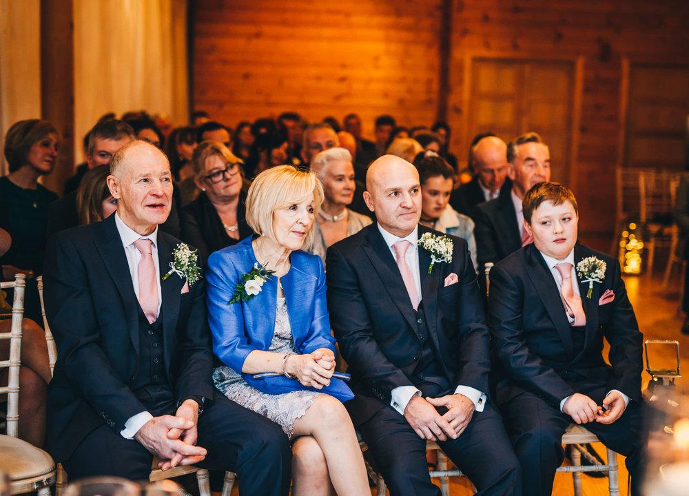 groom's family watch the ceremony