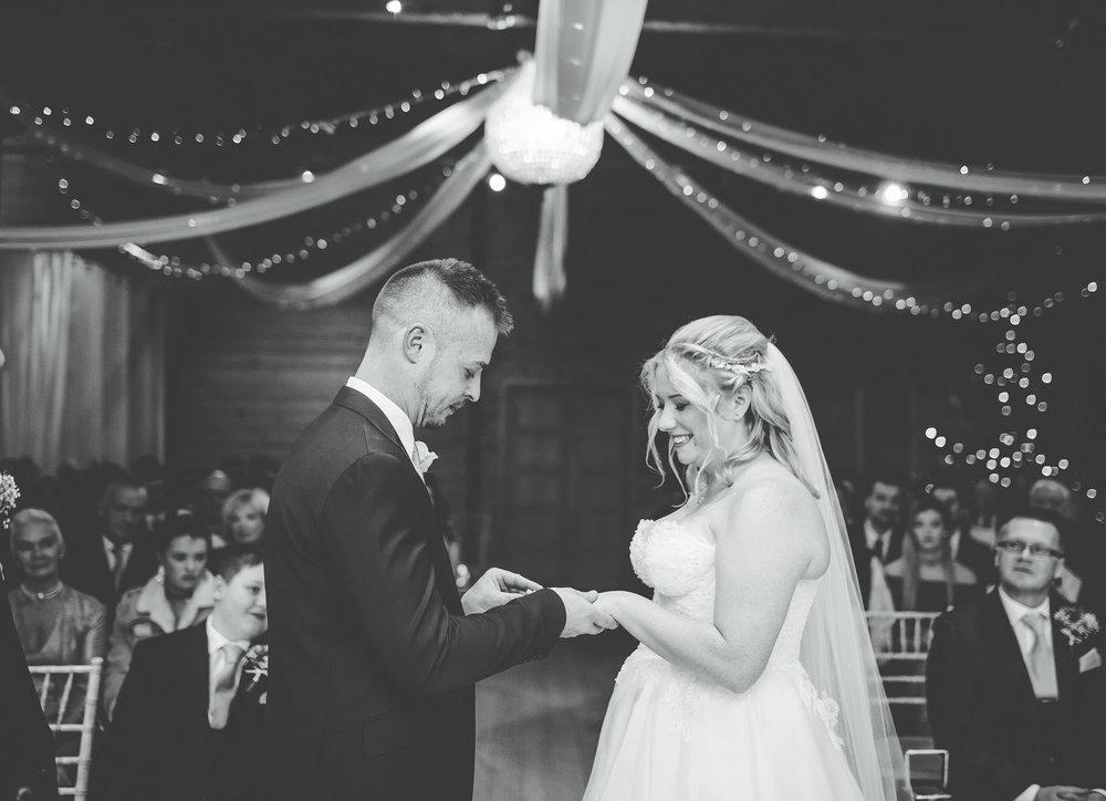 exchanging rings - styal lodge wedding