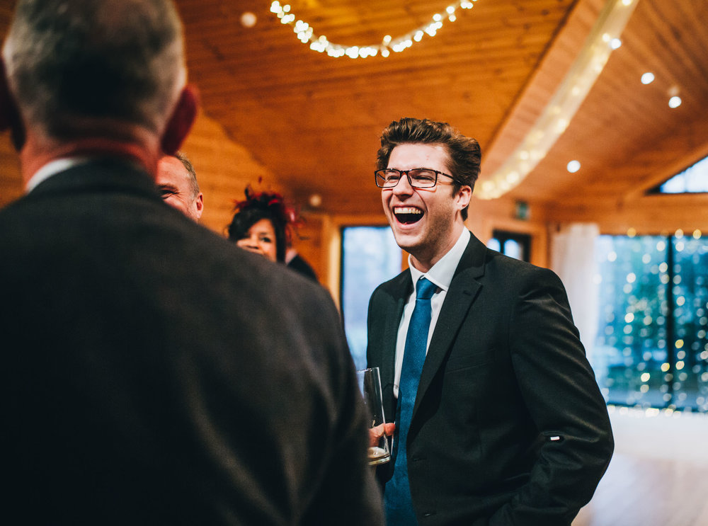 guests laughing at styal lodge - Cheshire wedding photography