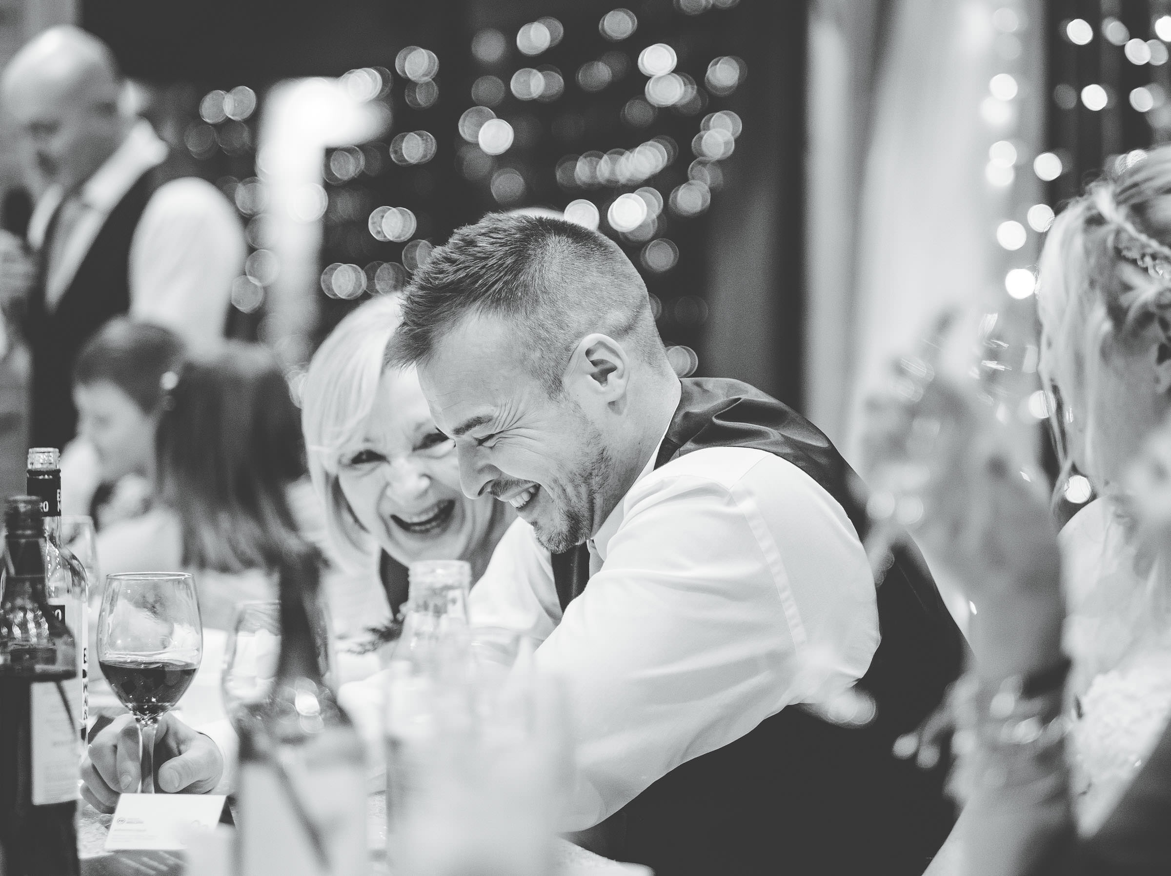 groom laughs at speeches - cheshire wedding photographer