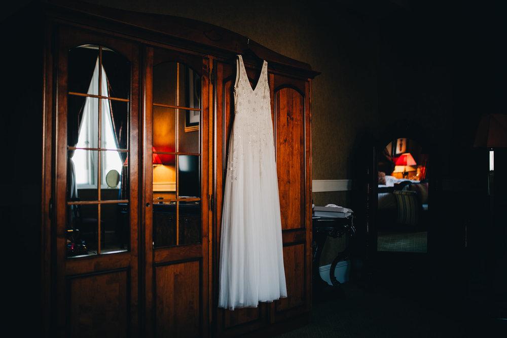 bride's dress hanging up - Manchester wedding photographer