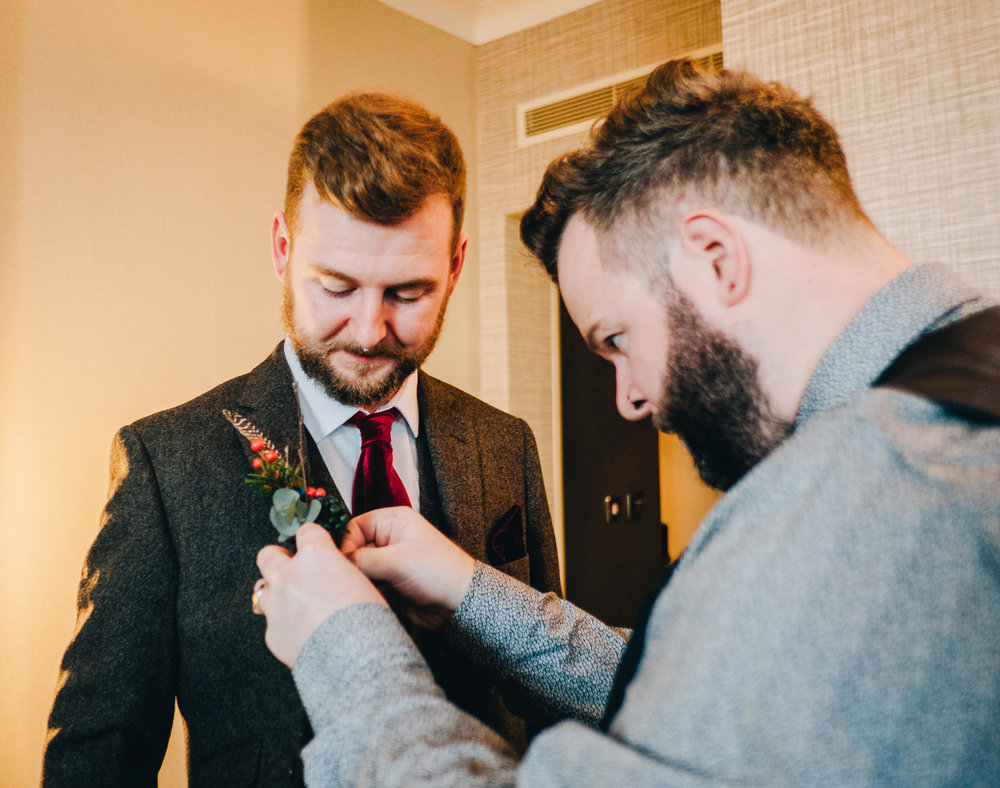 groom getting ready for Manchester wedding