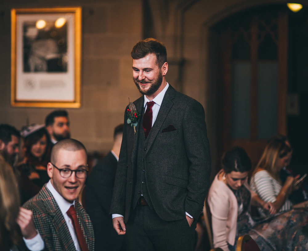 groom chats to guests before bride arrives at Manchester town hall