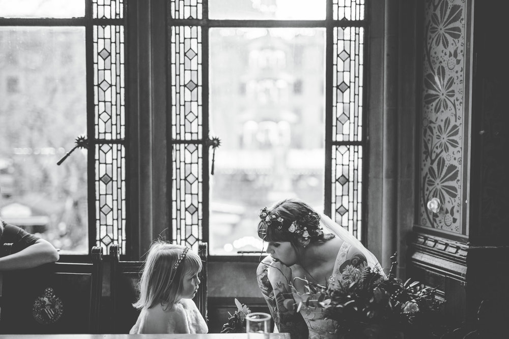 bride and flower girl inside Manchester town hall - documentary images