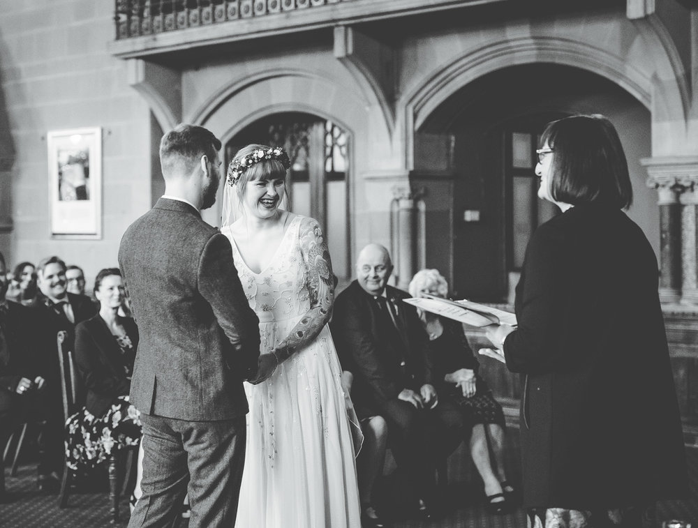 bride and groom exchange vows at Manchester town hall