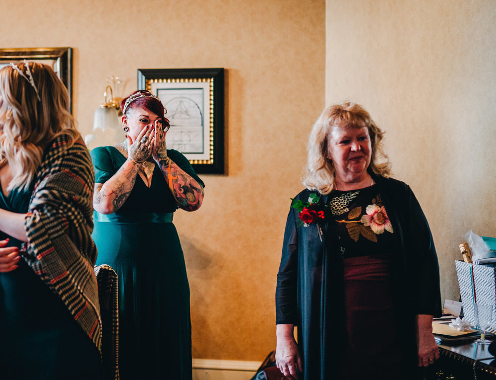 bridesmaid seeing bride in dress for the first time
