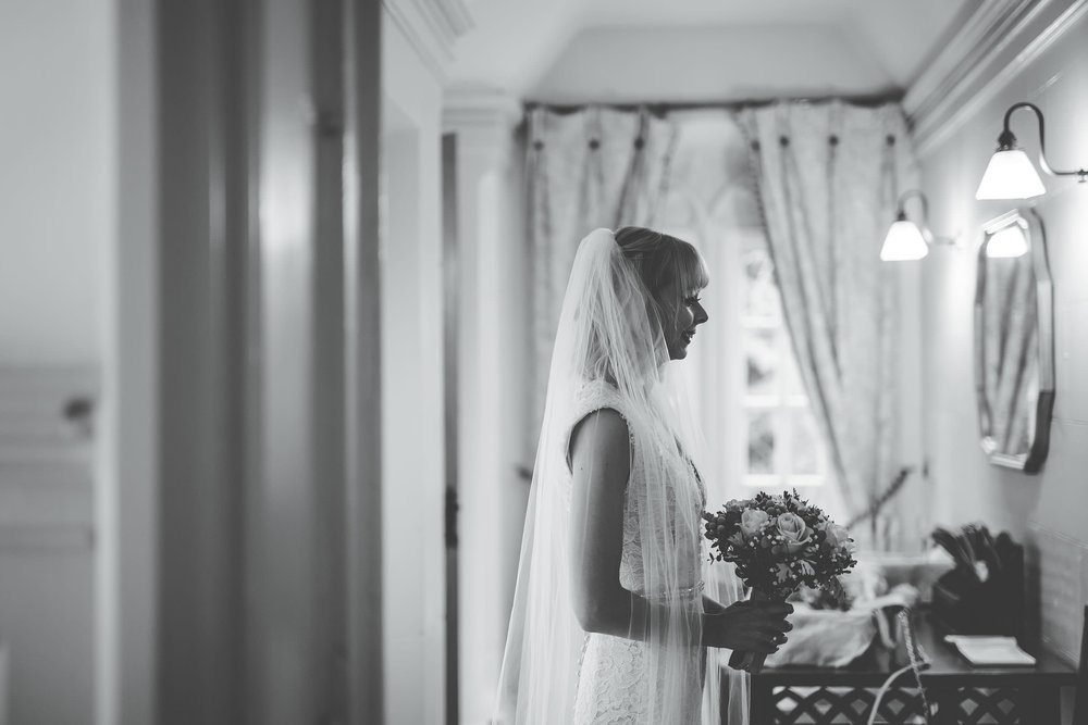 Black and white photo of the bride and her flowers. Creative wedding photographer in Shropshire.
