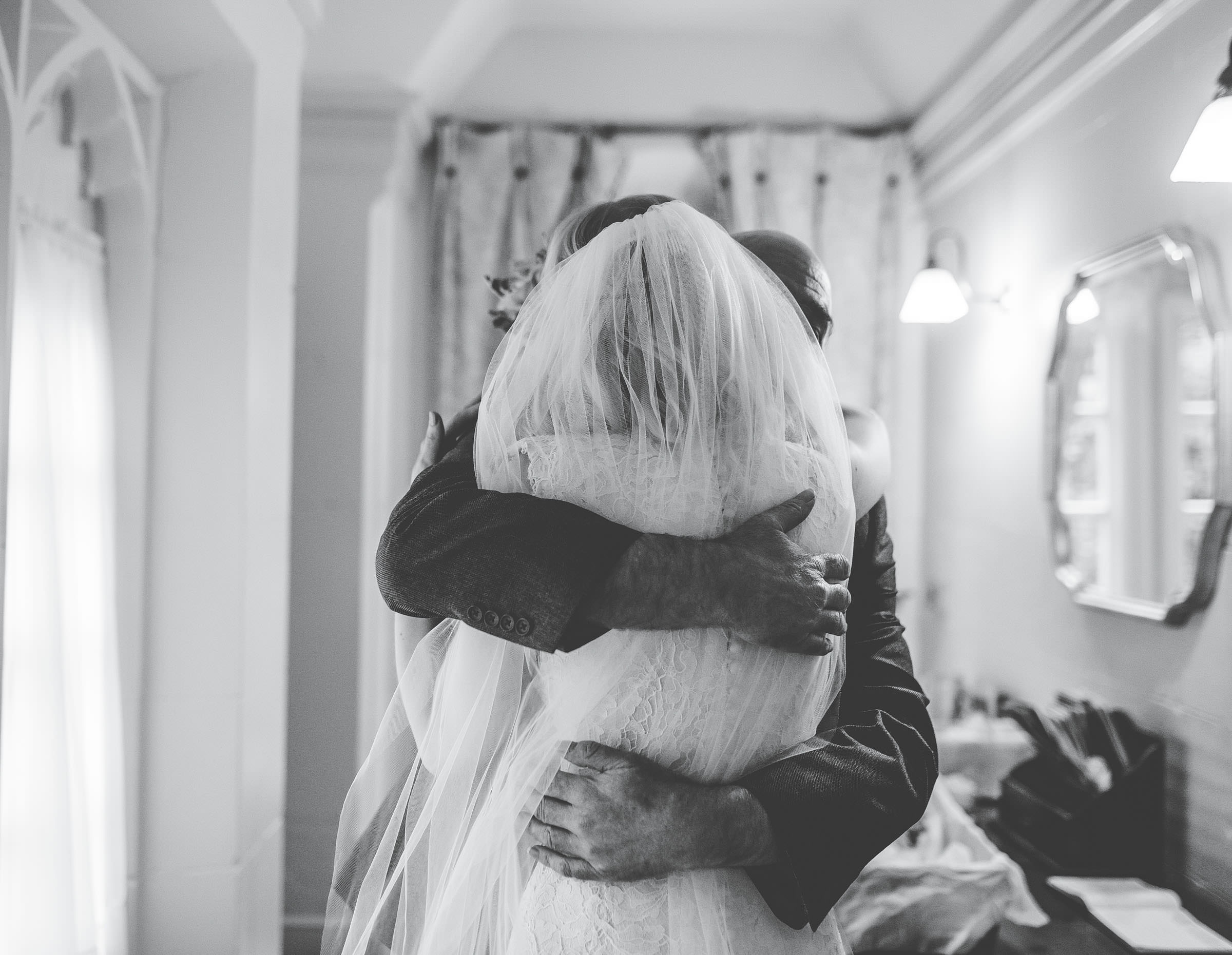 hugs with dad - natural wedding photography