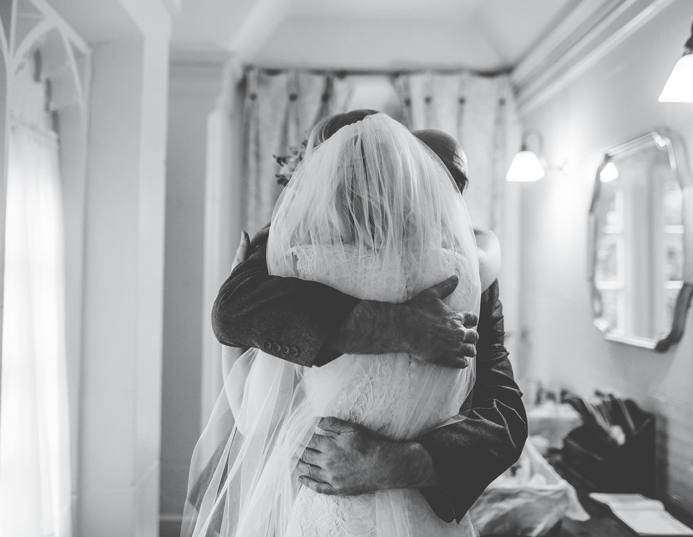 Hugs for the bride and her father. Winter wedding photography.