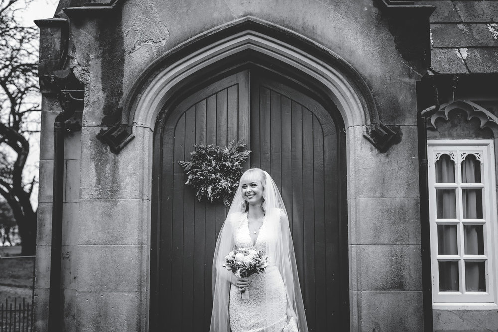The bride outside Combermere Abbey. Winter wedding.