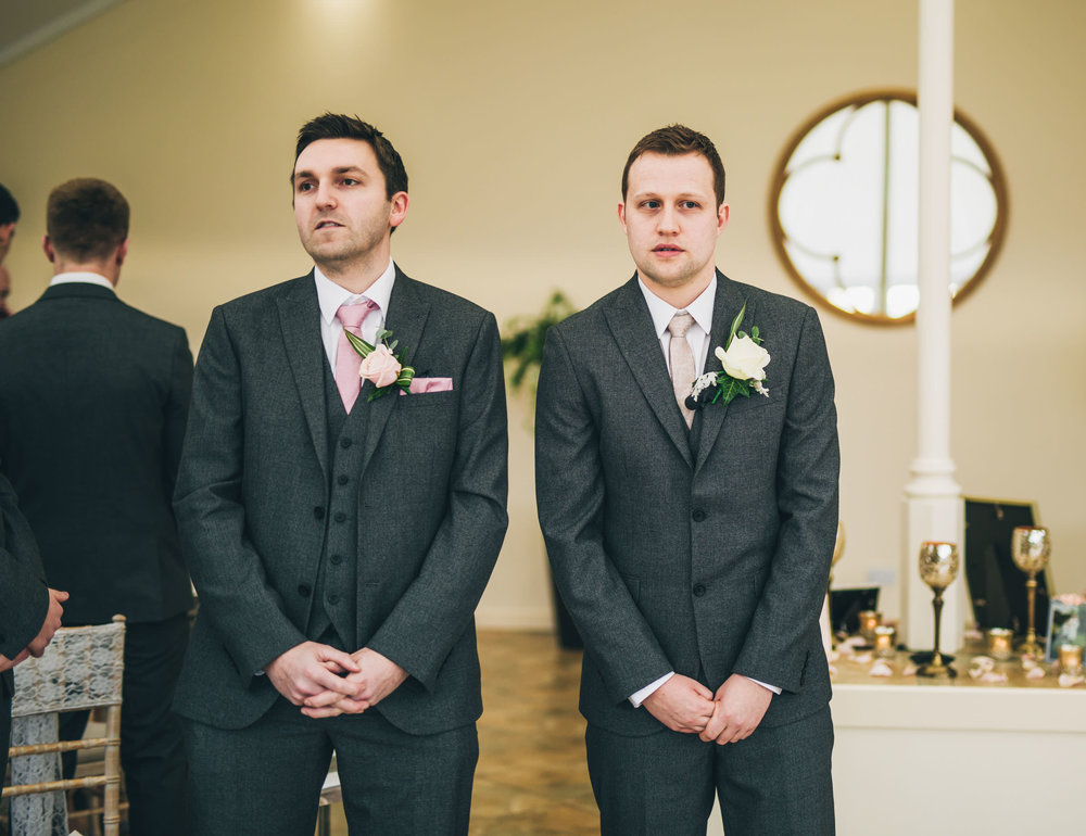 The groom and his best man waiting at the alter. Creative wedding photographer.