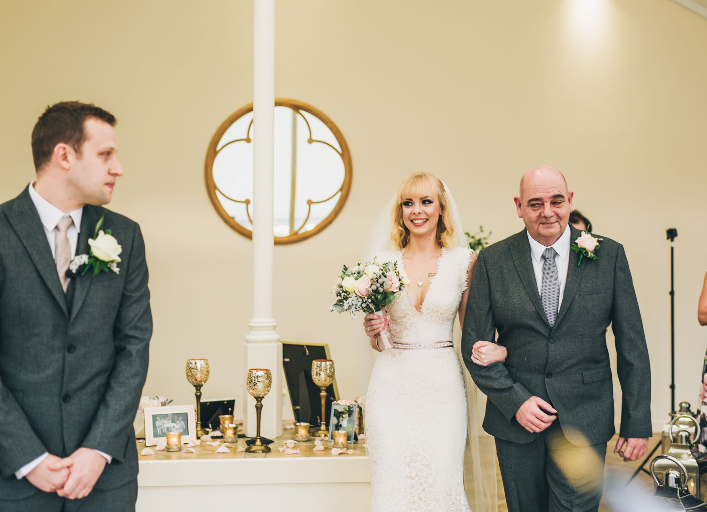 Bride enters the ceremony at combermere Abbey