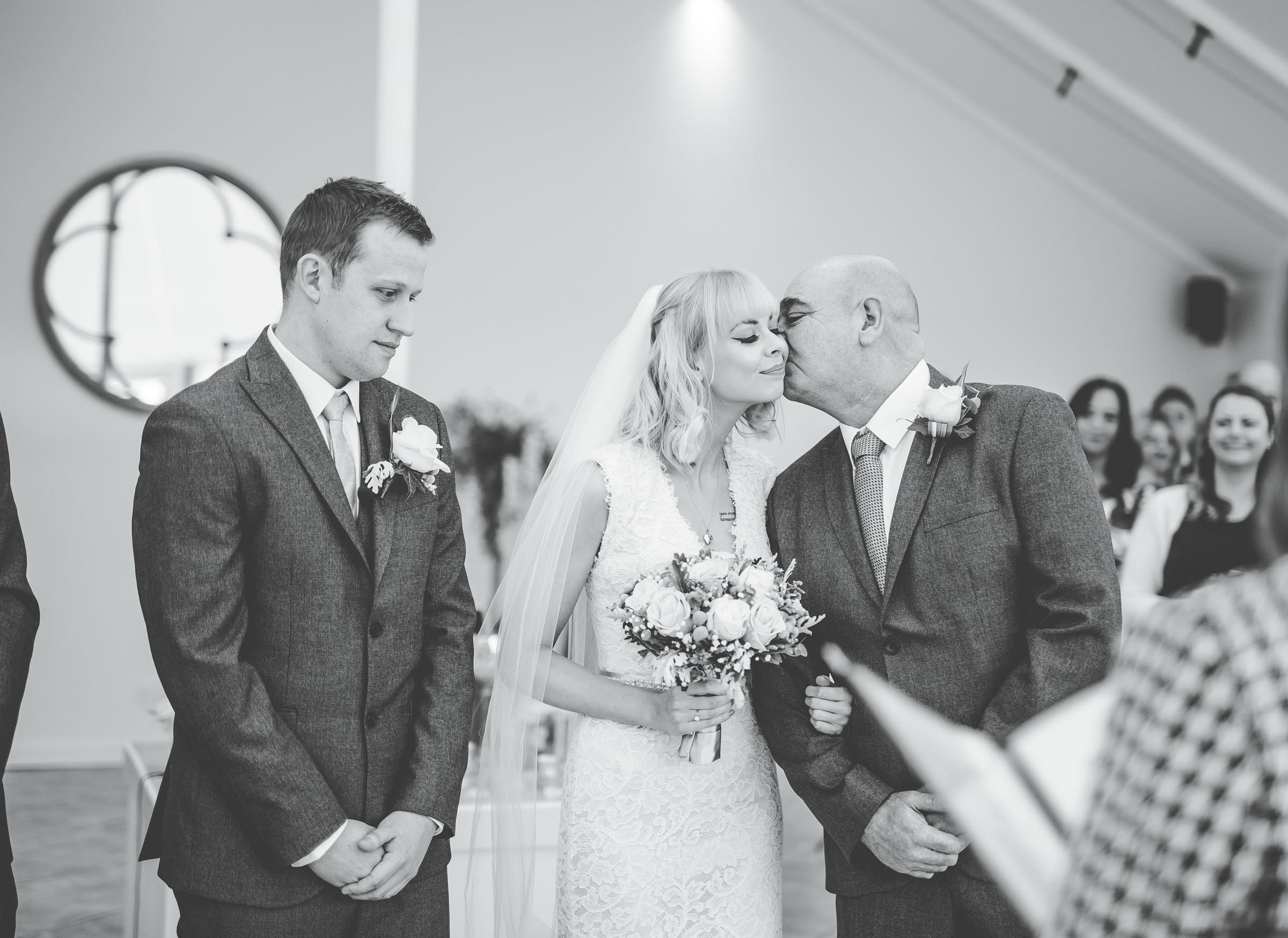 Father of the bride kisses daughter - Comberemere Abbey wedding