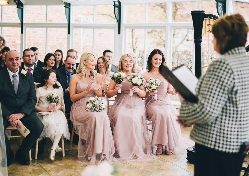 The bridesmaids all wearing pink. Documentary wedding photography in Shropshire.