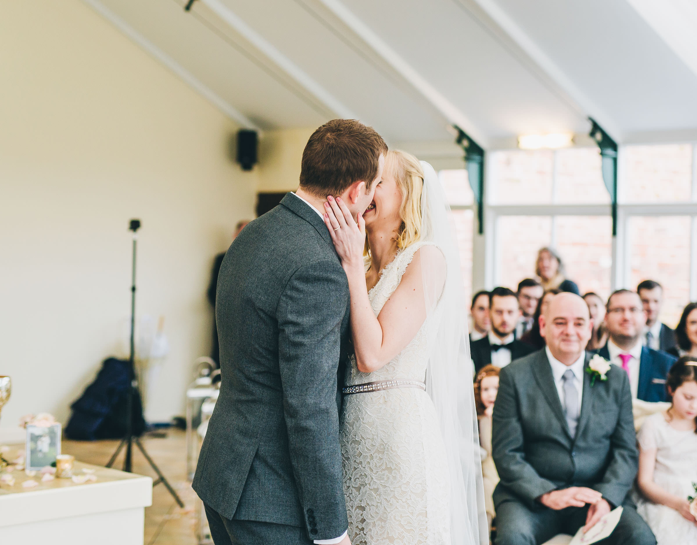 couple kiss - Combermere Abbey wedding photography