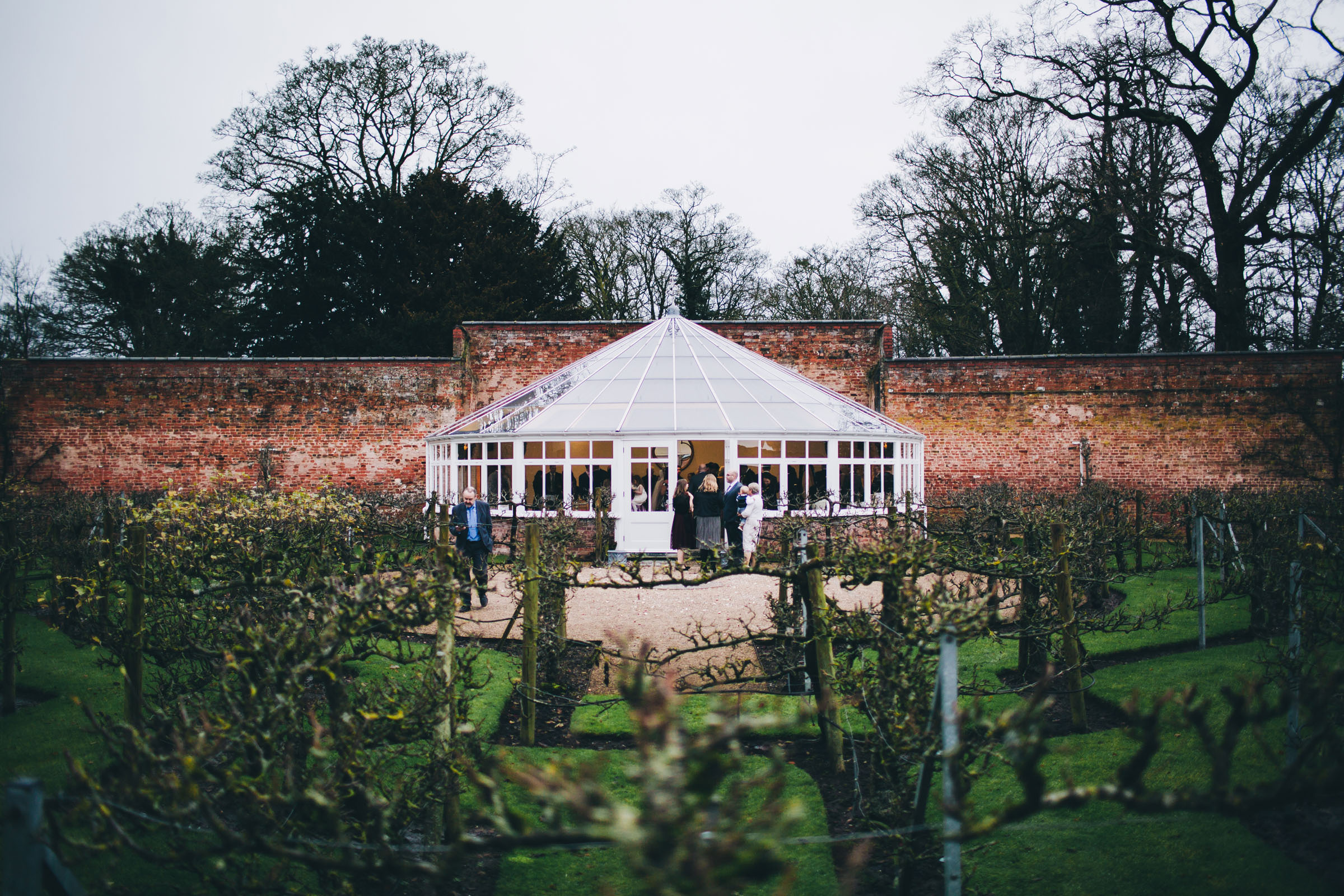 Guests outside the orangery at Combermere Abbey