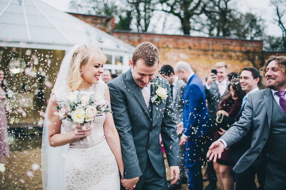 Confetti shot of the bride and groom. Combermere Abbey wedding pictures.