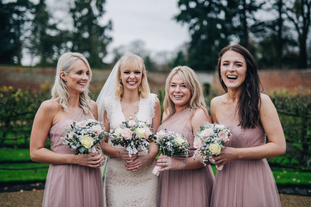 The bride and her bridesmaids. Creative wedding photographer.