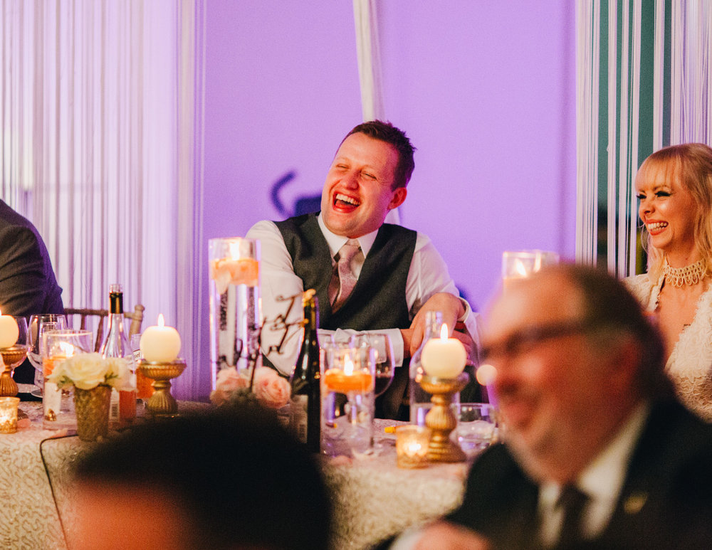 Laughter as the speeches are told. Documentary styled wedding photographer.