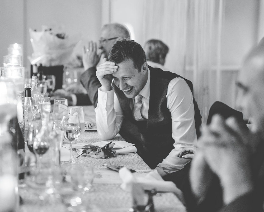 Laughter from wedding guests. Documentary styled wedding photographer.