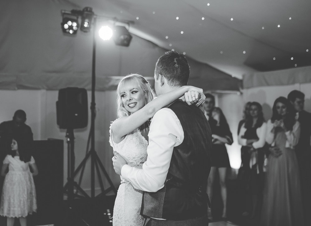 Black and white photo of the bride and groom dancing. Combermere Abbey for a wedding.