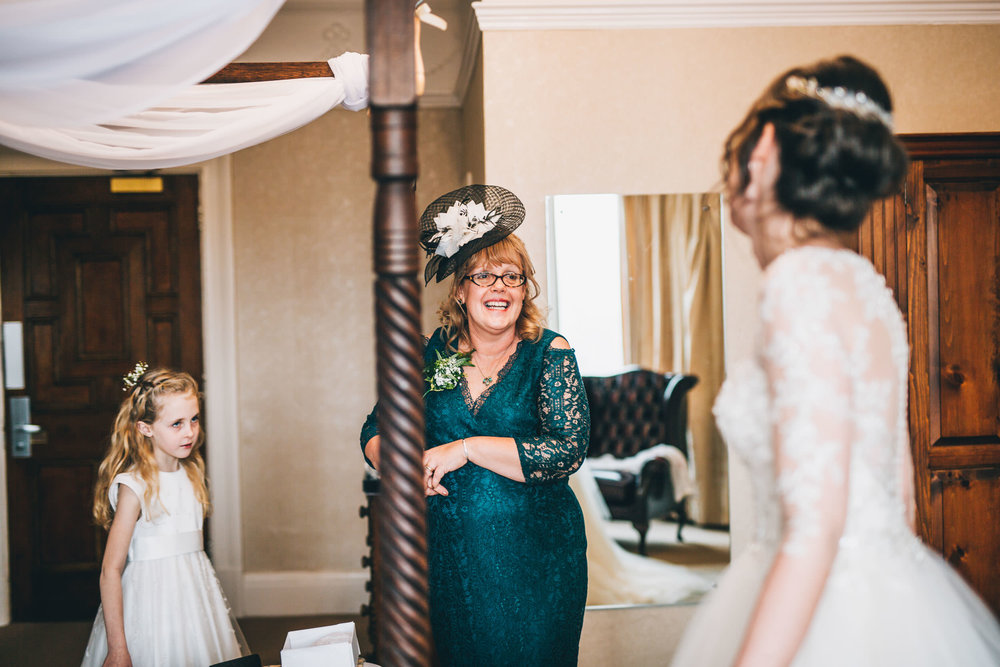 The bride and the mother of the bride. Documentary wedding photography.