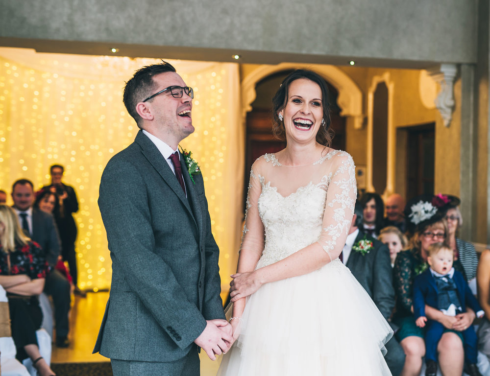 Laughter from the bride and groom during the ceremony. Documentary styled wedding photography from Lancashire.