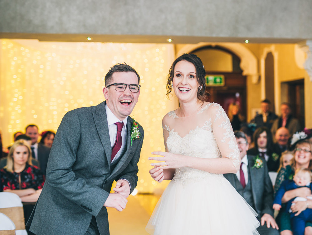 Laughter from the bride and groom.  Winter wedding photography.