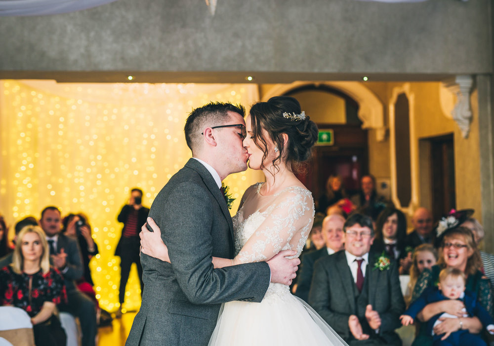 The bride and grooms first kiss. Documentary styled wedding photographer from Lancashire.