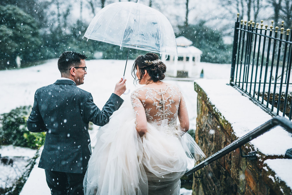 The bride and groom outside with the snow. Wedding in the snow.