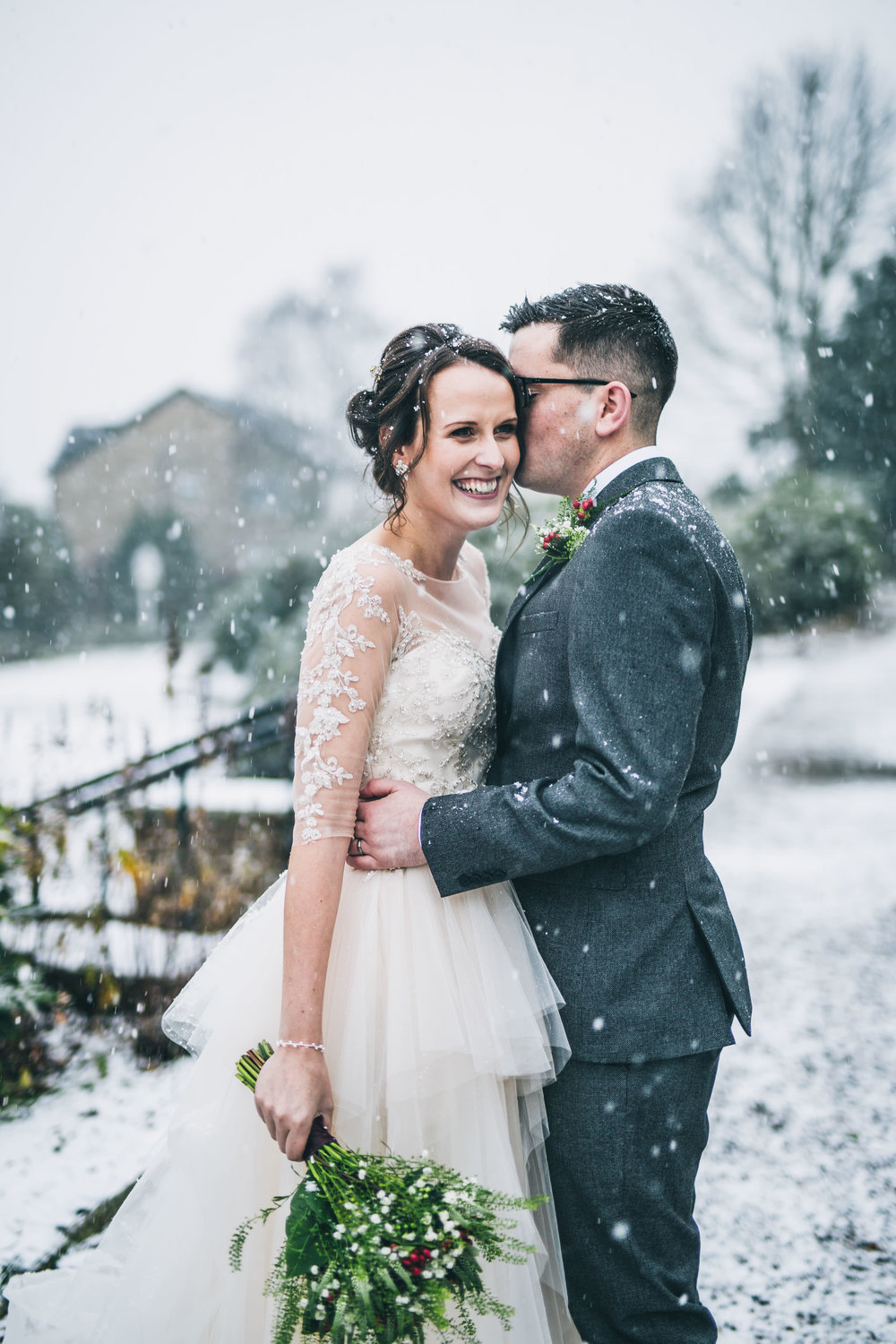The bride laughing with the groom. Winter wedding in Lancashire.