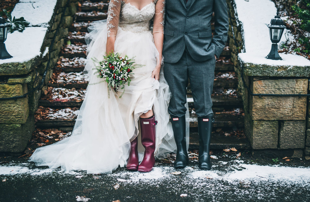 The wedding wellies of the bride and groom. Creative wedding photographer.