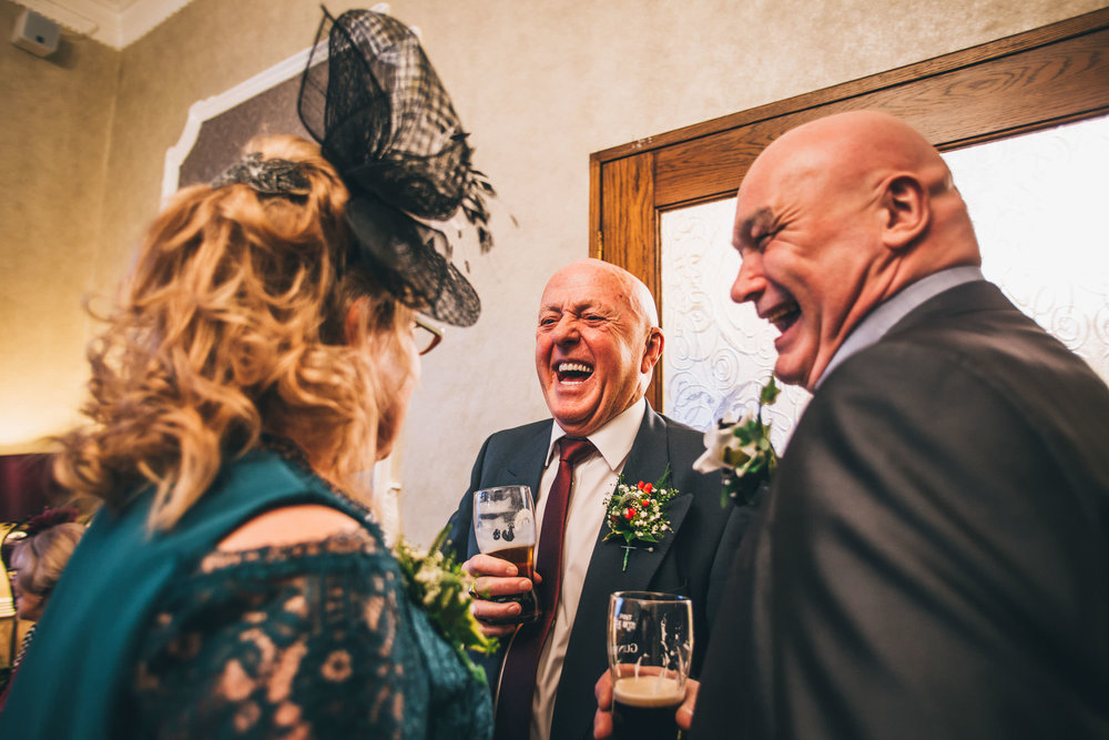 Laughter from wedding guests.