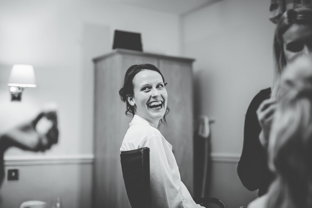 Black and white photo of the bride laughing. Winter wedding.